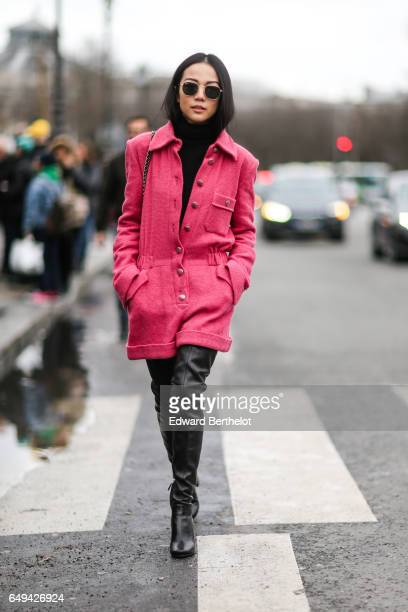Yoyo Cao wears a pink tweed jacket black turtleneck and black leather boots outside the Chanel show during Paris Fashion Week Womenswear Fall/Winter...