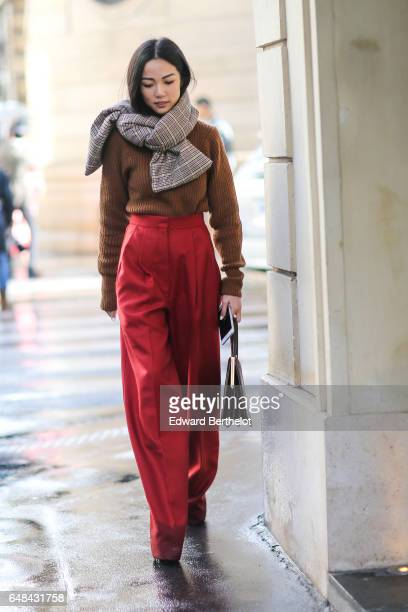 Yoyo Cao wears a scarf a brown wool pull over red pants outside the Valentino show during Paris Fashion Week Womenswear Fall/Winter 2017/2018 on...