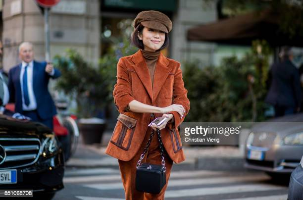 Yoyo Caowearing velvet suit flat cap is seen outside Prada during Milan Fashion Week Spring/Summer 2018 on September 21 2017 in Milan Italy