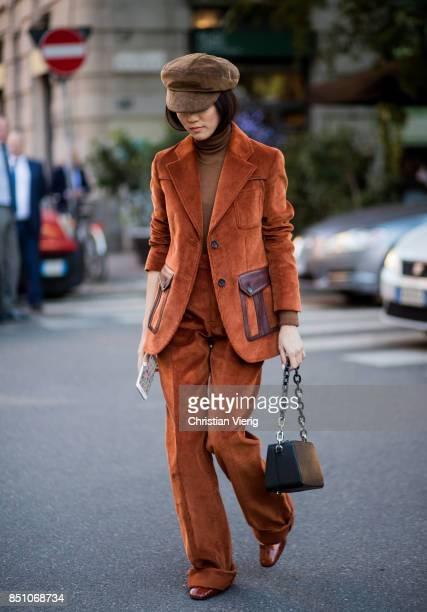 Yoyo Caowearing velvet suit flat cap is seen outside Prada during Milan Fashion Week Spring/Summer 2018 on September 21 2017 in Milan Italy