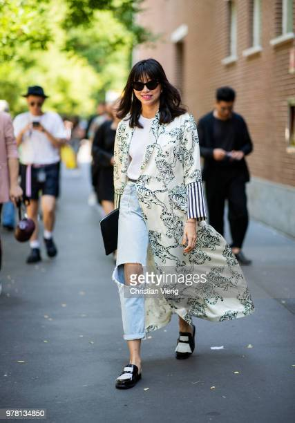 Yoyo Lu wearing kimono, ripped denim jeans is seen outside Fendi during Milan Men's Fashion Week Spring/Summer 2019 on June 18, 2018 in Milan, Italy.