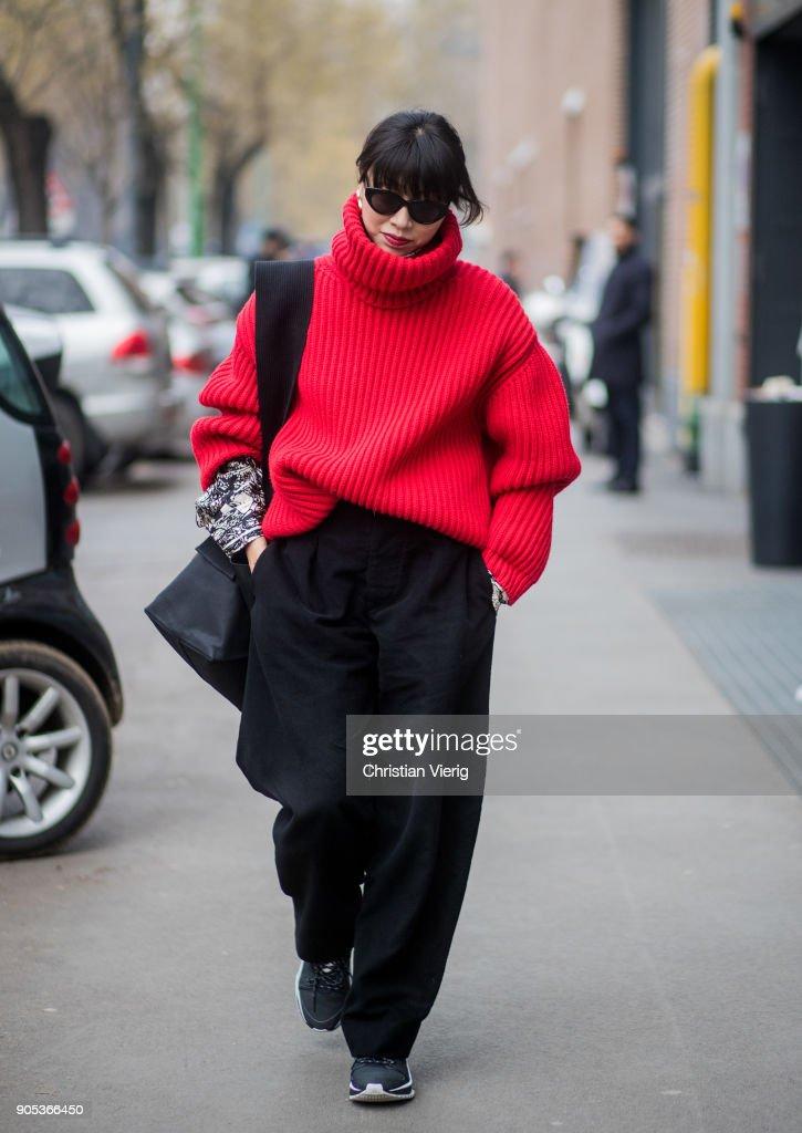 Yoyo Lu wearing red turtleneck, black wide leg pants is seen outside Fendi during Milan Men's Fashion Week Fall/Winter 2018/19 on January 15, 2018 in Milan, Italy.