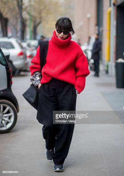 Yoyo Lu wearing red turtleneck black wide leg pants is seen outside Fendi during Milan Men's Fashion Week Fall/Winter 2018/19 on January 15 2018 in...