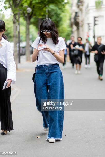 Yoyo Lu wearing wide leg denim jeans outside Paul Smith during Paris Fashion Week Menswear Spring/Summer 2018 Day Five on June 25 2017 in Paris France
