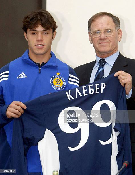 Yozheff Sabo vicepresident of Dynamo Kiev holds with Kleber his new Dynamo team shirt during his presentation after signing a five year contract with...