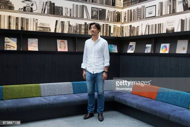 Yozo Kaneko president and chief operating officer of United Inc poses for a photograph at the company's office in Tokyo Japan on Thursday May 31 2018...