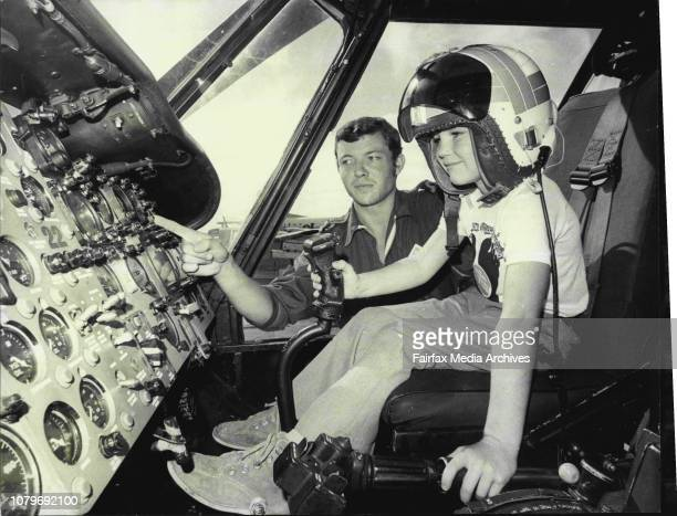 7 yr old Nigel Rooskov of Narooma pictured at the controls of a Wessex MK 31B Anti Submarine Helicopter on display at the display Sub Lt Phil Knowles...