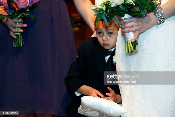 4 yr old ring bearer Myles Saint Louis Erica Stevens and Martin Hewett wed on Saturday April 9 2011 at the Calvary Baptist Church in Washigton DC The...