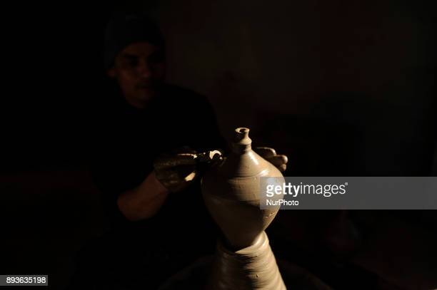 PRAJAPATI 40 yrs making Piggy Bank clay pot on his workshop at Pottery Square Bhaktapur Nepal on Friday December 15 2017 Nepalese Potter works on...