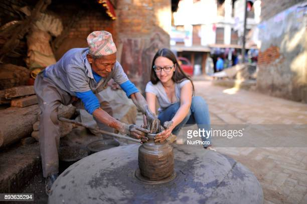 PRAJAPATI 72 yrs making Piggy Bank clay pot on his workshop at Pottery Square Bhaktapur Nepal on Friday December 15 2017 Nepalese Potter works on...