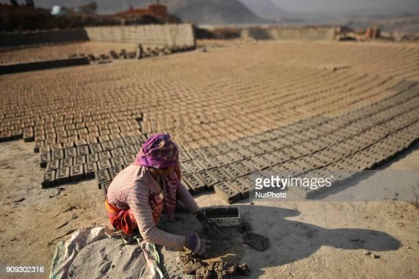 38 yrs old KALIMAYA PARI making raw bricks at a brick factory in Lalitpur Nepal on Tuesday January 23 2018 She used to make 600 700 bricks per day
