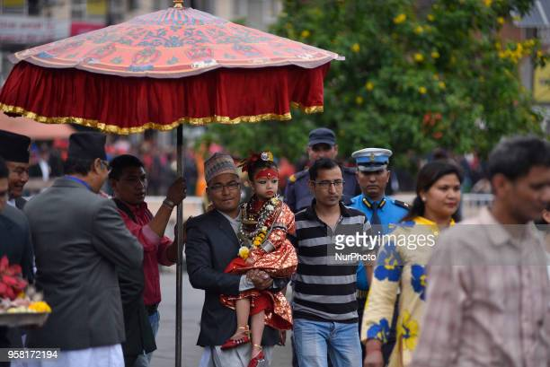 5 yrs old Living goddess of Patan Nihira Bajracharya arrives to observe the displaying bejeweled vest known as Bhoto to the public from the chariot...