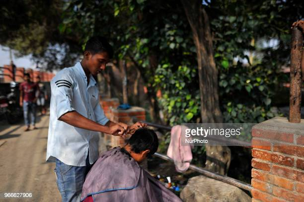 18 yrs old Raju Thakur permanent resident of Laxmipur Dhanusha cutting Hair along in the street of Kathmandu Nepal on Sunday June 03 2018 He used to...