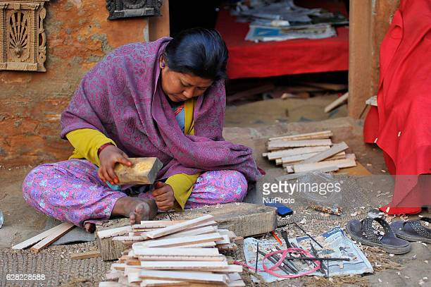 MAHARJAN 28 yrs old works on her carving business at Khokana Patan Nepal on Tuesday December 06 2016 Although her home was destroyed by last year's...