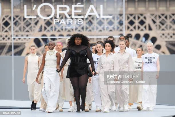 """Yseult and models walk the runway during the """"Le Defile L'Oreal Paris 2021"""" Womenswear Spring/Summer 2022 show as part of Paris Fashion Week on..."""