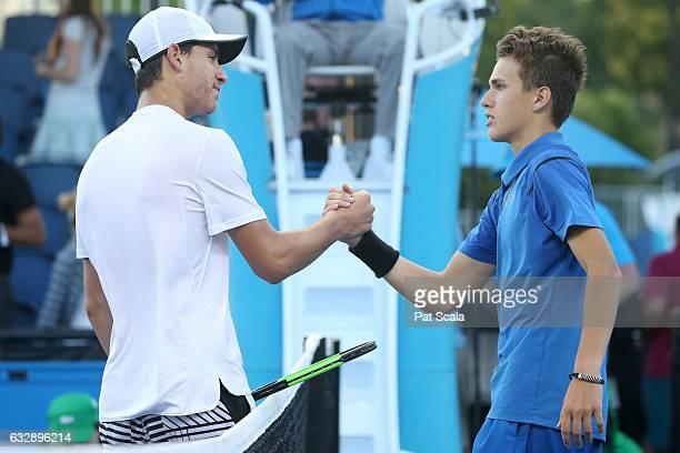 Yshai Oliel of Israel congratulates Zsombor Piros of Hungary after their Junior Boys Singles Final during the Australian Open 2017 Junior...