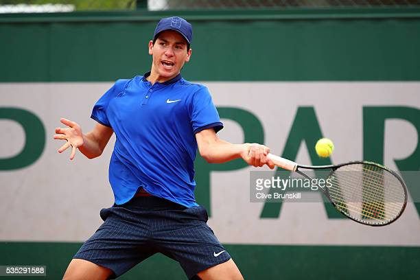 Yshai Oliel of Israel hits a backhand during the Boys Singles first round match against Kenneth Raisma of Estonia on day eight of the 2016 French...