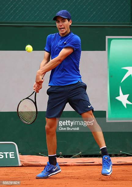 Yshai Oliel of Israel hits a forehand during the Boys Singles first round match against Kenneth Raisma of Estonia on day eight of the 2016 French...