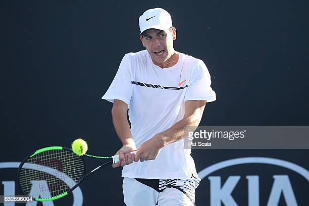 Yshai Oliel of Israel plays a backhand in his Junior Boys Singles Final against Zsombor Piros of Hungary during the Australian Open 2017 Junior...