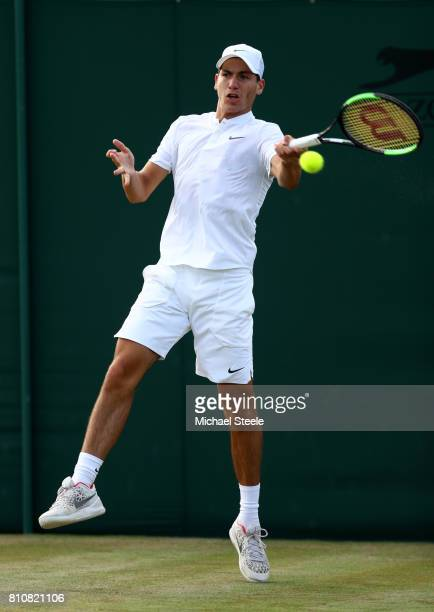 Yshai Oliel of Israel plays a forehand during the Boy's Singles first round match against Alexandre Rotsaert of the United States on day six of the...