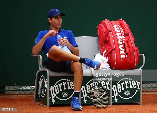 Yshai Oliel of Israel takes a break during the Boys Singles first round match against Kenneth Raisma of Estonia on day eight of the 2016 French Open...
