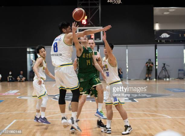 Yu An Chiang of Taiwan Beer attempts the basket under heavy defense during the SBL Finals Game Six between Taiwan Beer and Yulon Luxgen Dinos at Hao...