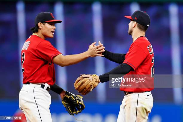 Yu Chang and Ernie Clement of the Cleveland Indians celebrate a 4-1 victory over the Kansas City Royals at Progressive Field on September 21, 2021 in...
