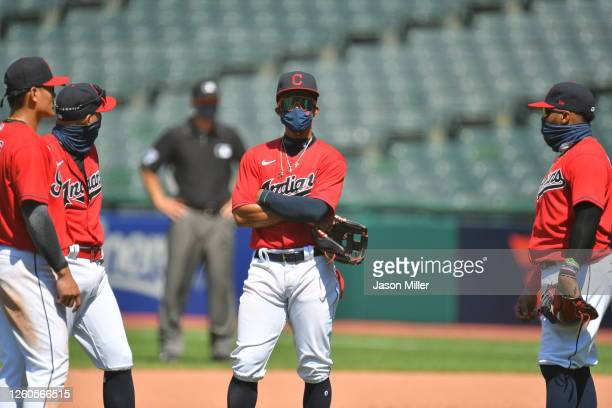 Yu Chang Cesar Hernandez Francisco Lindor and Carlos Santana of the Cleveland Indians all wait on the field during a pitching change during the...