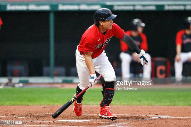 Yu Chang of the Cleveland Indians hits a three-run triple off Daniel Lynch of the Kansas City Royals during the first inning at Progressive Field on...
