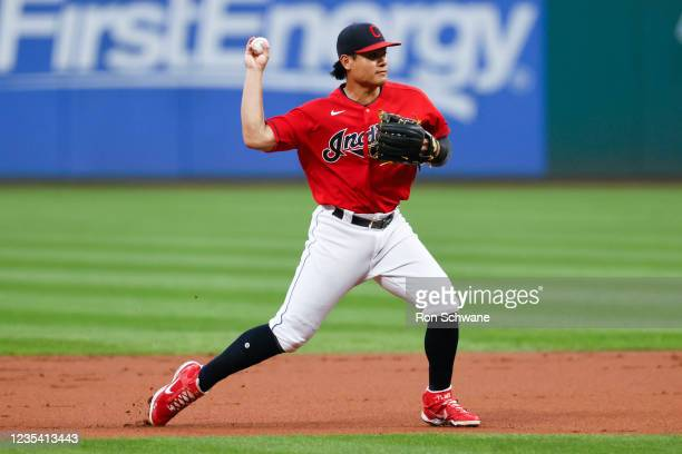 Yu Chang of the Cleveland Indians throws out Nicky Lopez of the Kansas City Royals at first base to complete a double play during the first inning at...