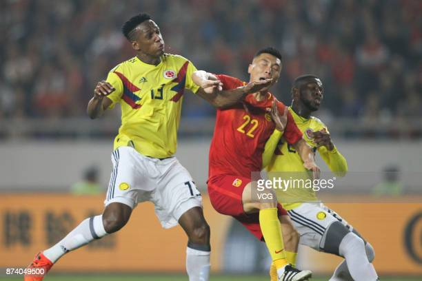 Yu Dabao of China National Team and Yerrry Mina of Columbia National Team compete for the ball during the international friendly match between China...