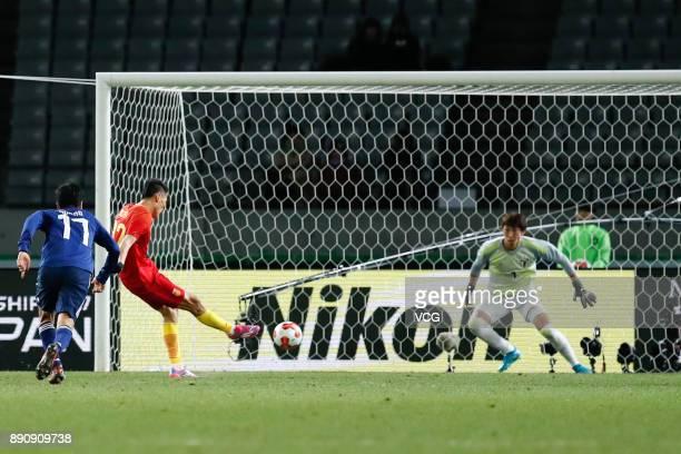 Yu Dabao of China takes a penalty kick during the EAFF E1 Men's Football Championship between Japan and China at Ajinomoto Stadium on December 12...