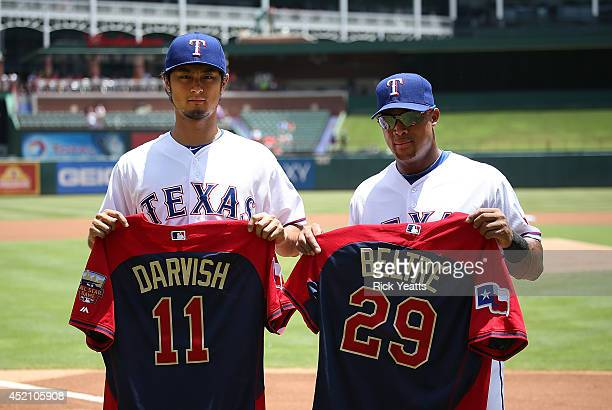Yu Darvish Adrian Beltre of the Texas Rangers receive their All Star Jerseys for the up coming MLB All Star Game before the start of the game against...