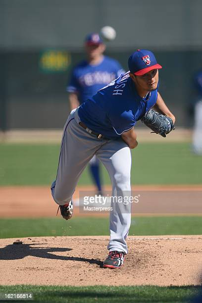 Yu Darvish of Texas Rangers throws during Texas Rangers Spring Training at Surprize Stadium on February 18 2013 in Surprize Arizona