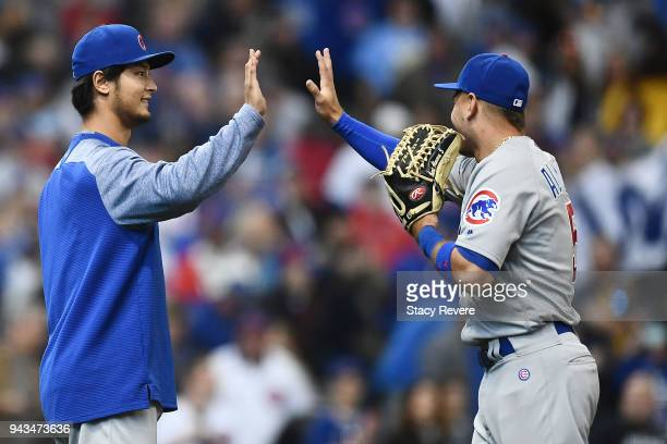 Yu Darvish of the Chicago Cubs celebrates a victory over the Milwaukee Brewers with Albert Almora Jr #5 at Miller Park on April 8 2018 in Milwaukee...