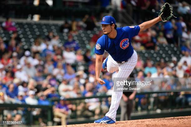 Yu Darvish of the Chicago Cubs delivers a pitch in the second inning of the spring training game against the Arizona Diamondbacks at Sloan Park on...