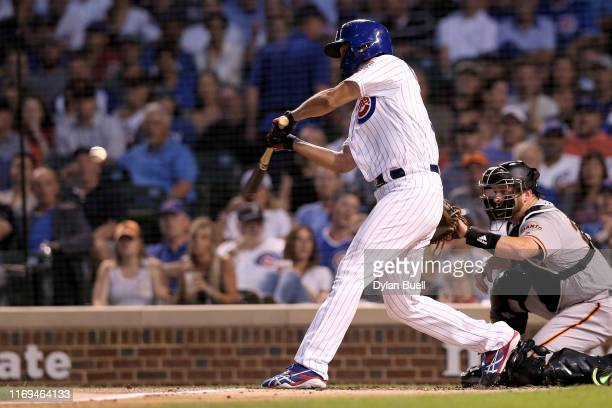 Yu Darvish of the Chicago Cubs hits a single in the second inning against the San Francisco Giants at Wrigley Field on August 21 2019 in Chicago...