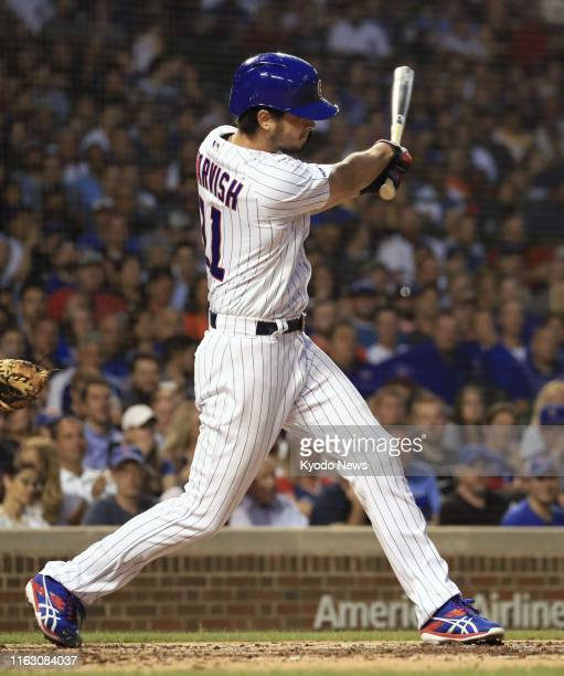 Yu Darvish of the Chicago Cubs hits an RBI single in the second inning of the game against the San Francisco Giants at Wrigley Field in Chicago on...