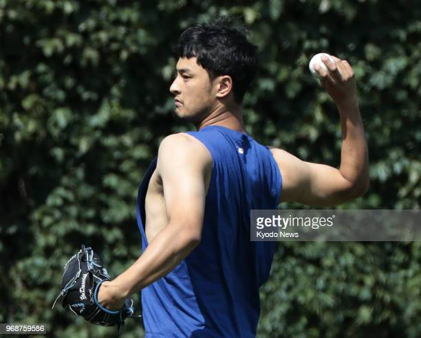 Yu Darvish of the Chicago Cubs plays catch before a game against the Philadelphia Phillies in Chicago on June 6 2018 ==Kyodo