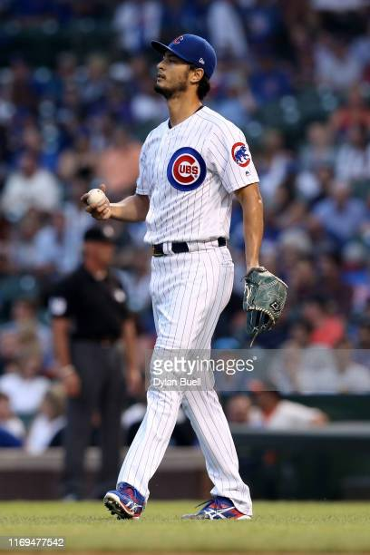 Yu Darvish of the Chicago Cubs reacts after giving up a home run in the first inning against the San Francisco Giants at Wrigley Field on August 21...