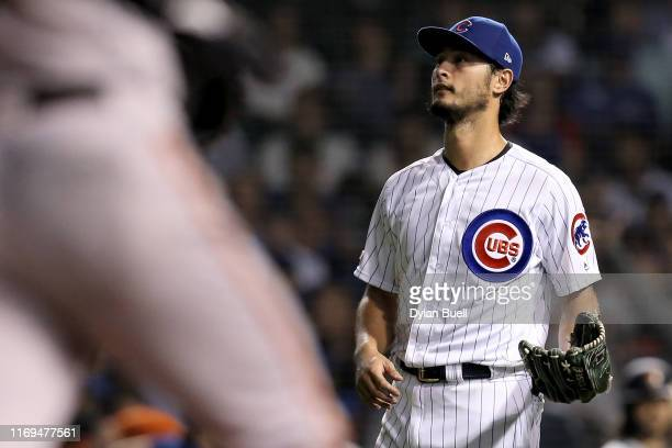 Yu Darvish of the Chicago Cubs reacts after giving up a home run to Kevin Pillar of the San Francisco Giants in the sixth inning at Wrigley Field on...