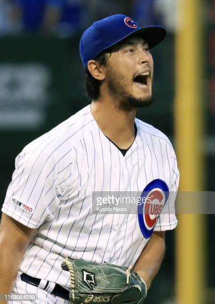 Yu Darvish of the Chicago Cubs shouts during the first inning of the game against the San Francisco Giants at Wrigley Field in Chicago on Aug 21 2019...