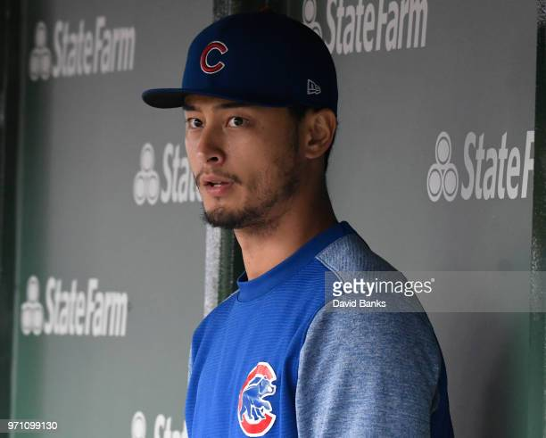 Yu Darvish of the Chicago Cubs sits in the dugout in a game against the Pittsburgh Pirates during the second inning on June 10 2018 at Wrigley Field...