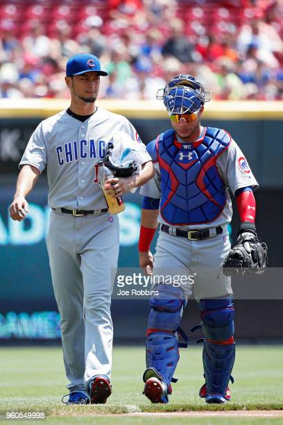 Yu Darvish of the Chicago Cubs talks to Willson Contreras after warming up before the game against the Cincinnati Reds at Great American Ball Park on...