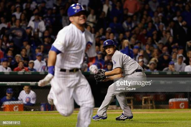 Yu Darvish of the Los Angeles Dodgers fields a bunt hit by Willson Contreras of the Chicago Cubs in the fourth inning during game three of the...