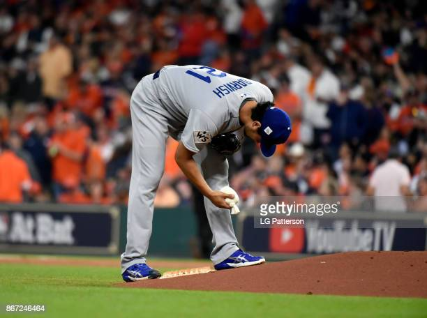 Yu Darvish of the Los Angeles Dodgers grabs the rosin bag during Game 3 of the 2017 World Series against the Houston Astros at Minute Maid Park on...