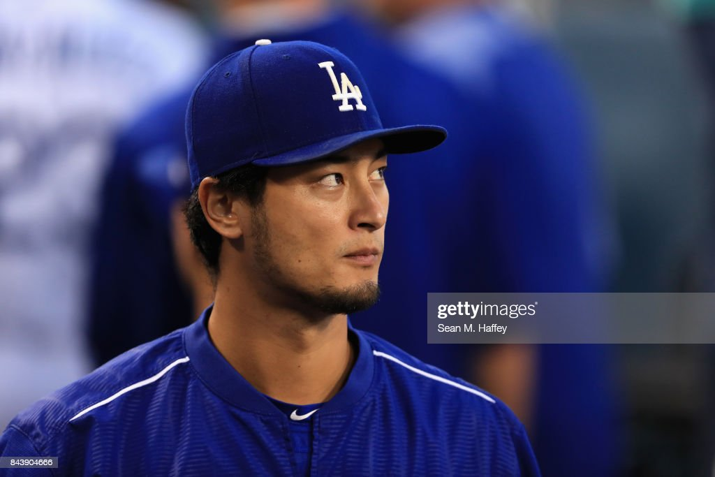 Yu Darvish #21 of the Los Angeles Dodgers looks on from the dugout during the first inning of a game against the Arizona Diamondbacks at Dodger Stadium on September 5, 2017 in Los Angeles, California.