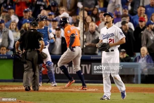 Yu Darvish of the Los Angeles Dodgers reacts after George Springer of the Houston Astros hit a tworun home run during the second inning in game seven...