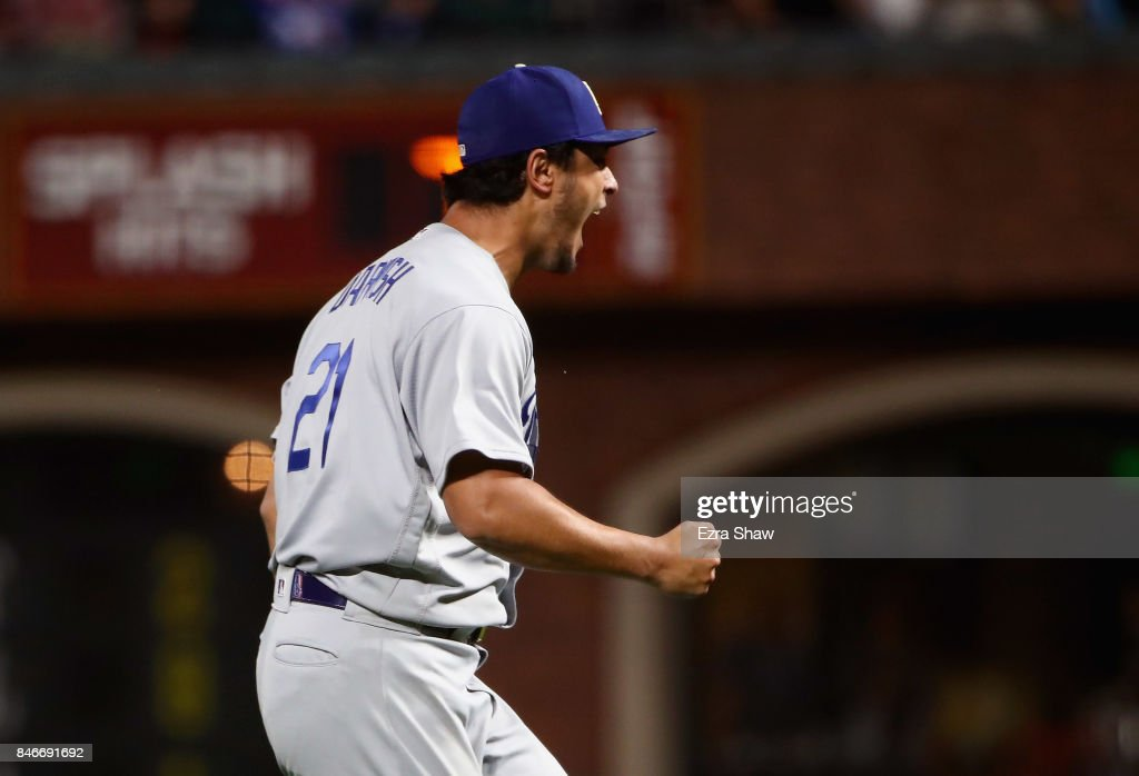 Yu Darvish #21 of the Los Angeles Dodgers reacts after the Dodgers turned a double play to end the seventh inning of their game against the San Francisco Giants at AT&T Park on September 13, 2017 in San Francisco, California.