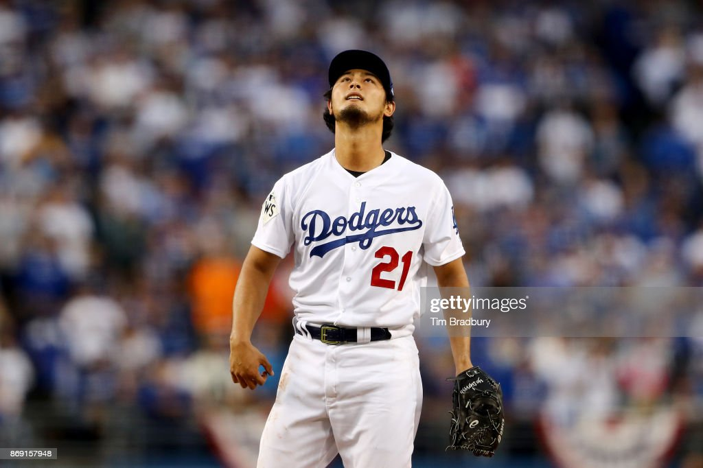 Yu Darvish #21 of the Los Angeles Dodgers reacts in the first inning against the Houston Astros in game seven of the 2017 World Series at Dodger Stadium on November 1, 2017 in Los Angeles, California.